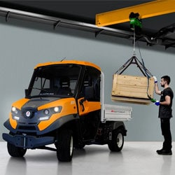 A robust orange and black road legal electric truck