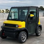 Black and yellow EP AMP 2 Seat Electric Vehicle