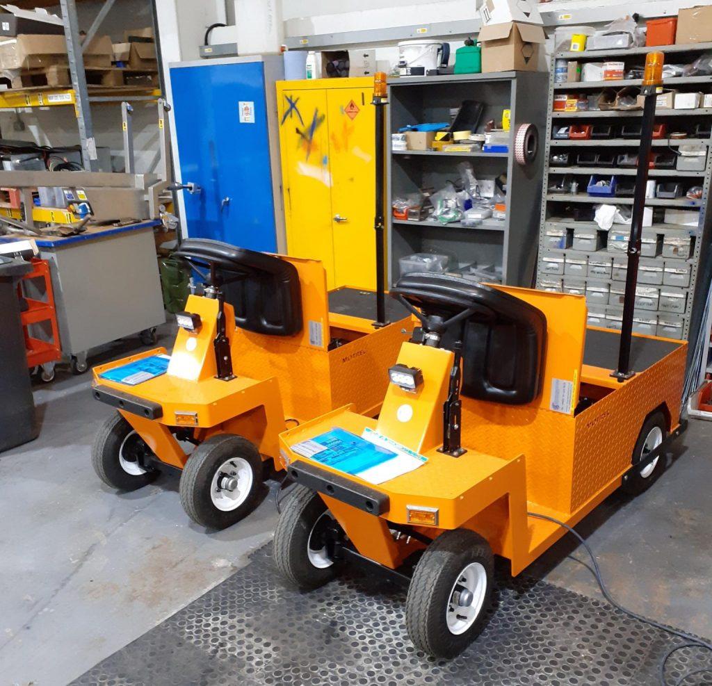 2 Orange e250 Electric Tugs