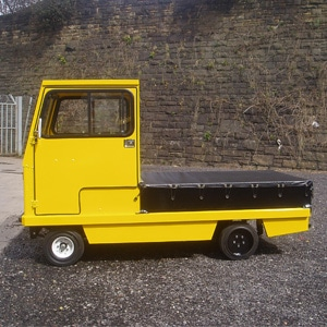 Yellow MC 660 Electric Industrial Burden Carrier Side View