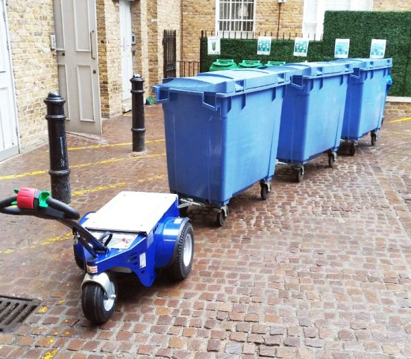 Jobmaster HD Electric Pedestrian Tug towing blue bins