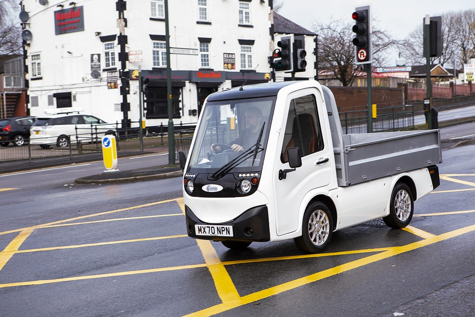 X-Cell Road Legal Electric Utility Vehicle passing through traffic lights