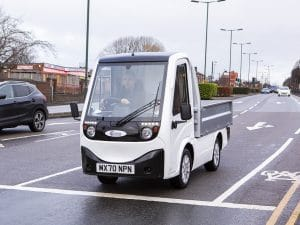 Man driving X-Cell Road Legal Electric Utility Vehicle