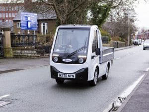 White X-Cell Road Legal Electric Utility Vehicle On Road