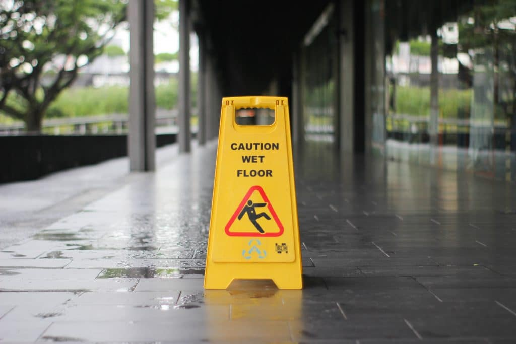 Wet Floor Sign On Walkway