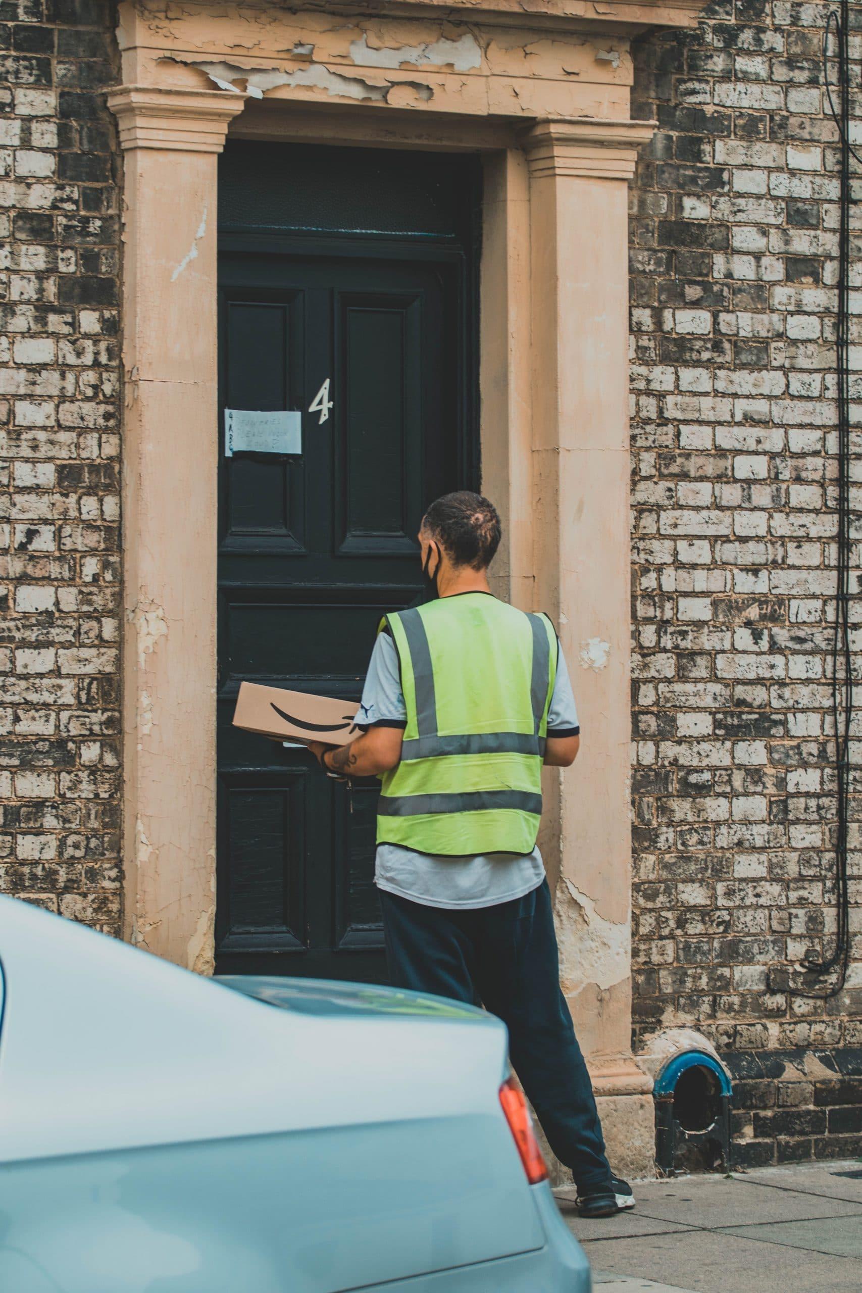 man delivery parcel to door
